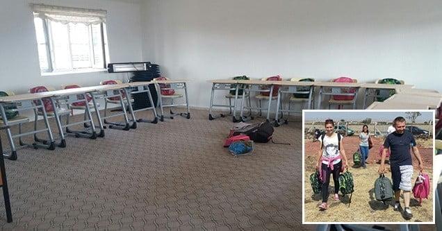 Köy okulunu boyayan gönüller kırtasiye yardımında bulundu