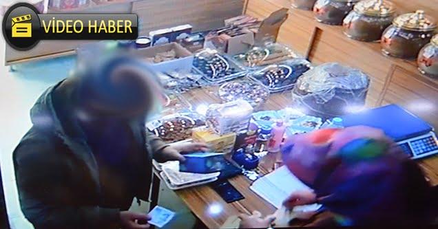 Sahte parayla alışveriş yaptığı iddia edilen kişi kameraya yansıdı